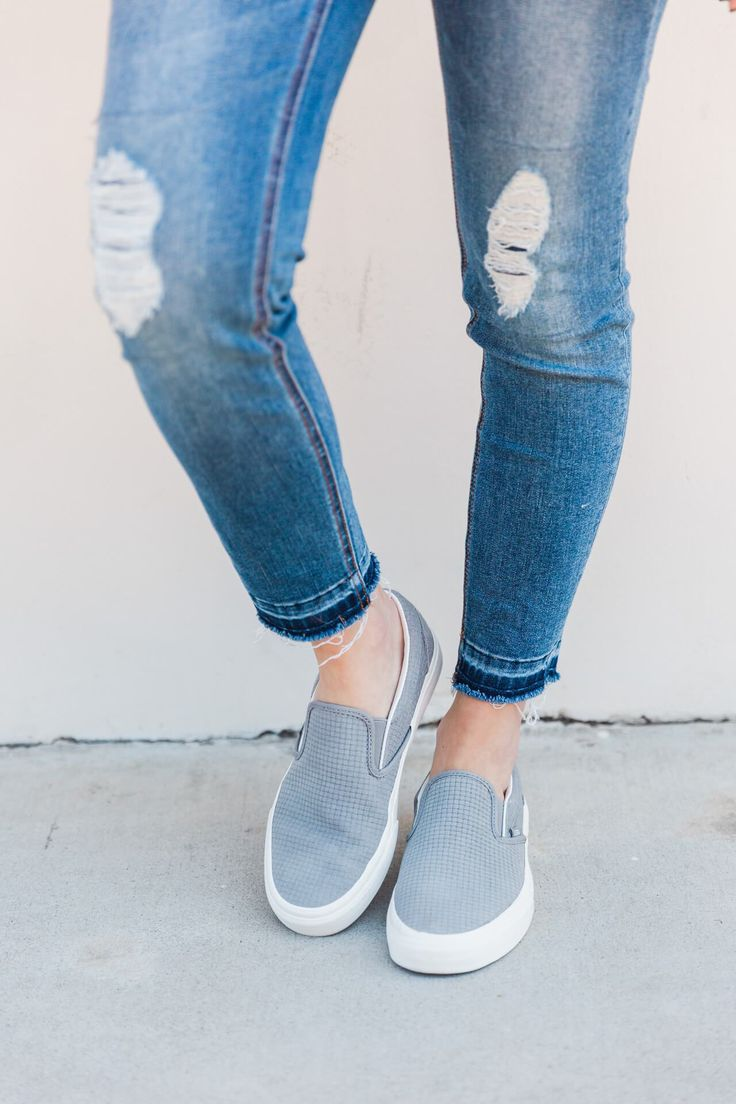 distressed jeans with gray vans slip on sneakers