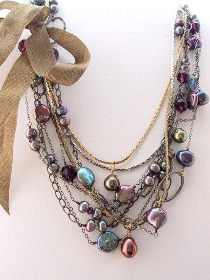 A beautiful mix of colored pearls and assorted chains | by Unknown
