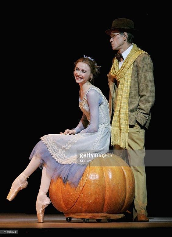 Svetlana Zakharova, as Cinderella, and Viktor Barykin, as The Storyteller, of the Moscow Bolshoi Theatre Cinderella Ballet perform at the Royal Opera House in Covent Garden on August 7, 2006 in London, England.
