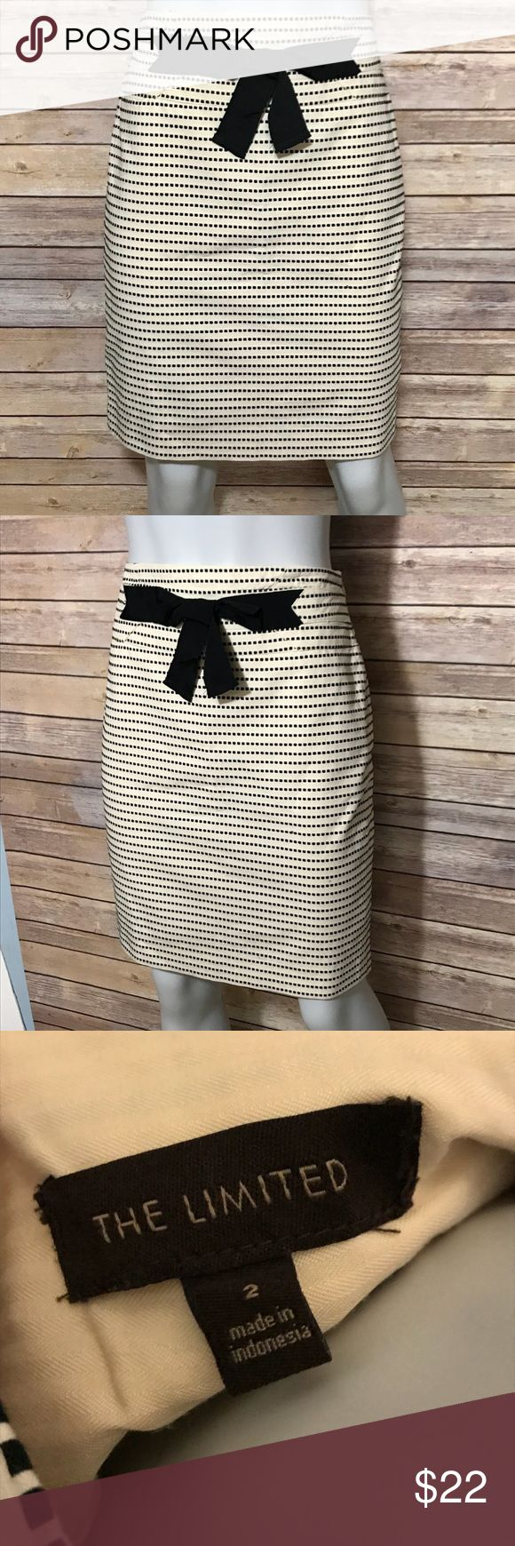 {the limited} cream and black striped pencil skirt Cream colored skirt with dotted horizontal stripe pattern. Bow detail on front at waist. Zips up the side. Pretty, lined skirt is neutral colored and would go well with many tops. The Limited Skirts Pencil