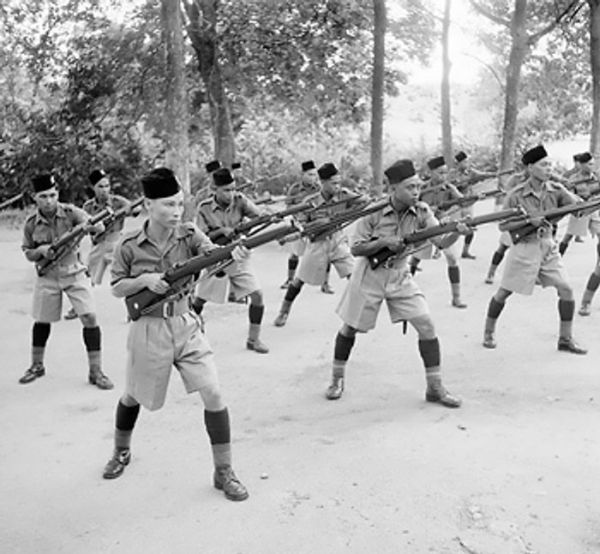 Men of the British Malay Regiment performing bayonet practice, Singapore, Oct. 1941