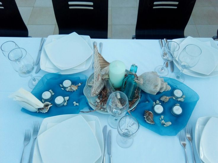 Blue & White seashell table decor.  www.royalblueevents.gr