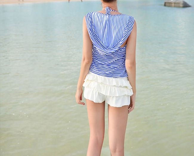 Such a cute swimsuit!  It may be a bikini but the coverup for the top is adorable!