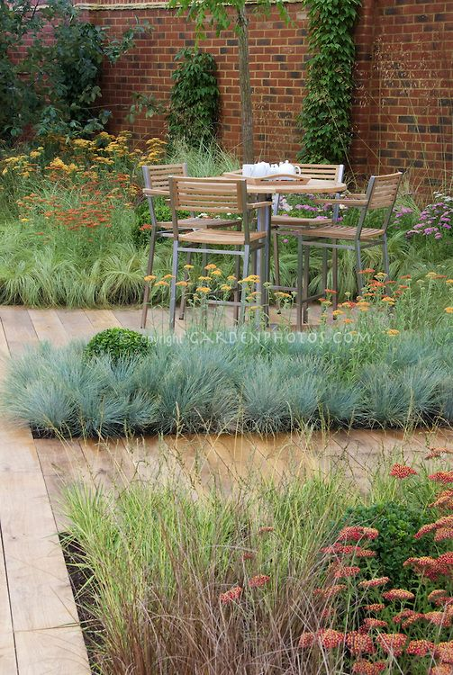 Backyard deck landscaping with wooden path garden plants for Outdoor tall grass plants