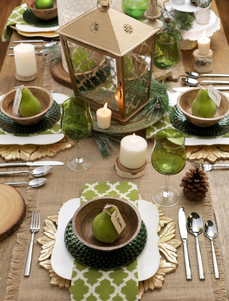 Table setting with a lantern centerpiece on a cake stand, try it! Glam, gold and green will wow your guests! Click through to our designHAPPY blog for more entertaining inspiration!