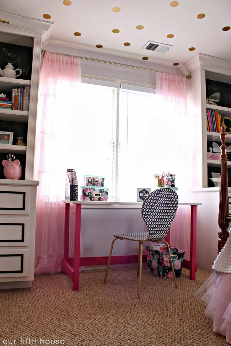 little girl's desk area - center desk over the window with bookcases and cabinets on either side