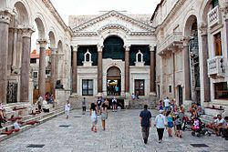 Peristyle, Split 1.jpg  Diocletian's Palace (Croatian: Dioklecijanova palača, pronounced [diɔklɛt͡sijǎːnɔʋa pǎlat͡ʃa]) is a palace in the city of Split, that was built by the Roman emperor Diocletian at the turn of the fourth century AD.  Diocletian built the massive palace in preparation for his retirement on 1 May 305 AD. It lies in a bay on the south side of a short peninsula running out from the Dalmatian coast, four miles from Salona, the capital of the Roman province of Dalmatia. The…