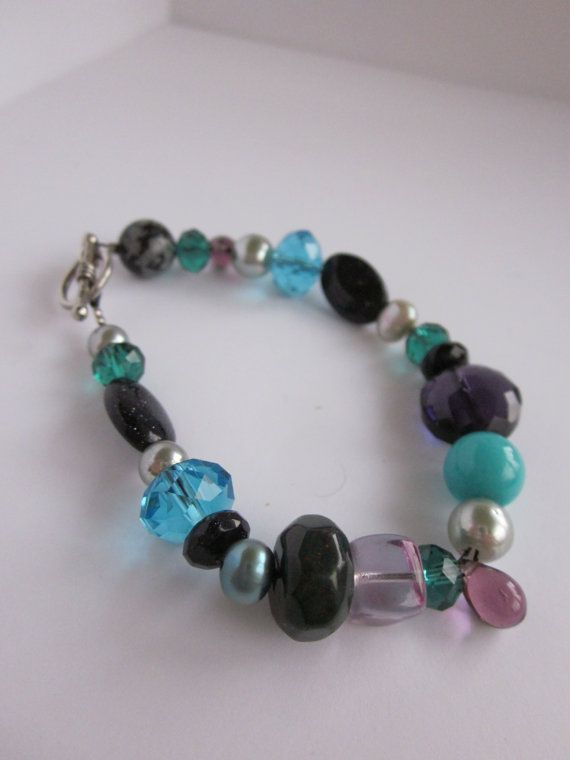 Check out this item in my Etsy shop https://www.etsy.com/listing/213610955/beaded-bracelet-in-purple-teal-and-green