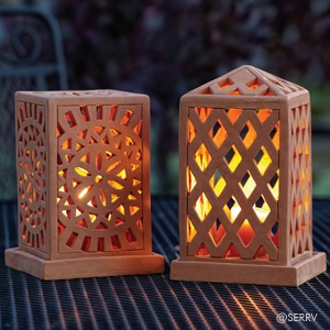 Terracotta Lanterns  Openwork terracotta lanterns emit a lovely glow when lit, emphasizing the carved geometric design of each. Top lifts off base for placement of tea light or votive (not included). Sold separately. A SERRV exclusive.    This item was designed by Thuaiprue Khagandra Tripura of CORR - The Jute Works while participating at SERRV's 2010 Design Camp. Read more!