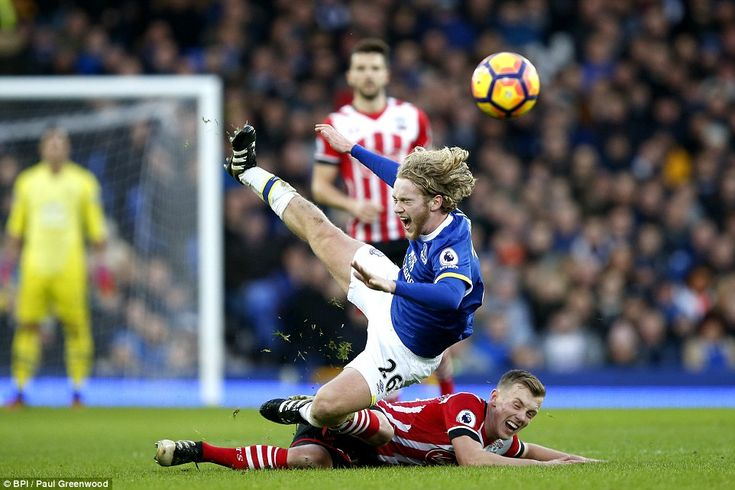 Tom Davies is fouled by James Ward-Prowse of Southampton, leading to the midfielder being booked