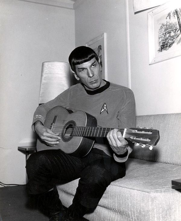 This pointy-eared alien and his acoustic instrument.