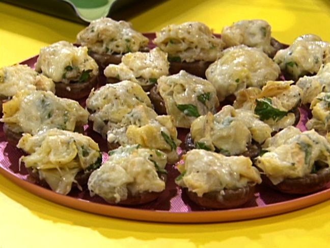 Artichoke and Cheese Stuffed Mushrooms... I am not a mushroom fan so substitute with french bread.