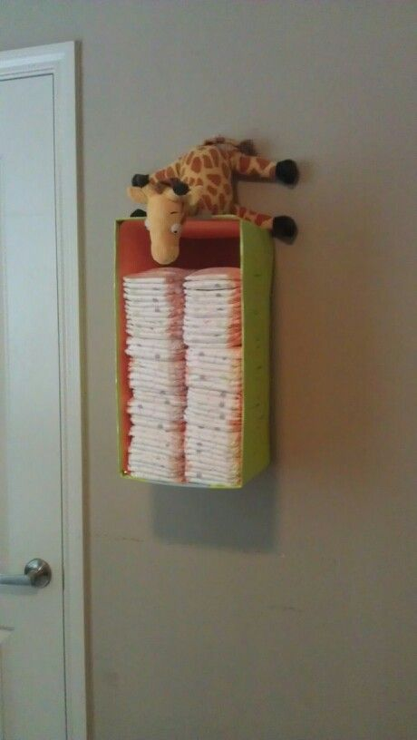 Diaper storage made out of diaper box and scrapbook paper.  My first DIY.  :)
