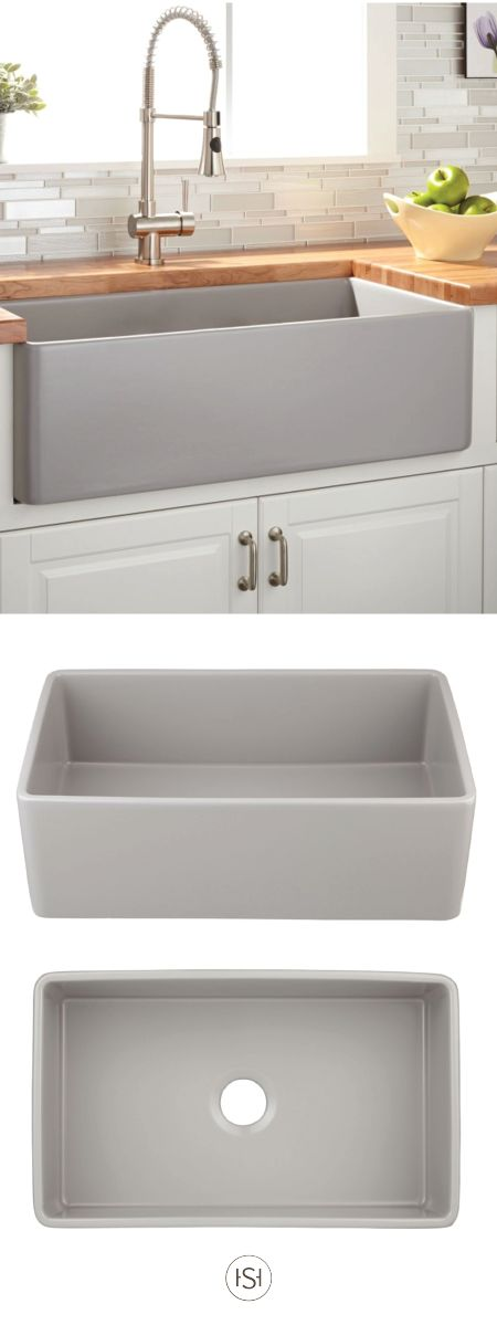 """We love the look of combining this 30"""" Reinhard Fireclay Farmhouse Sink with bright white kitchen cabinets and a butcher block countertop. Check out Signature Hardware for even more timeless design inspiration."""