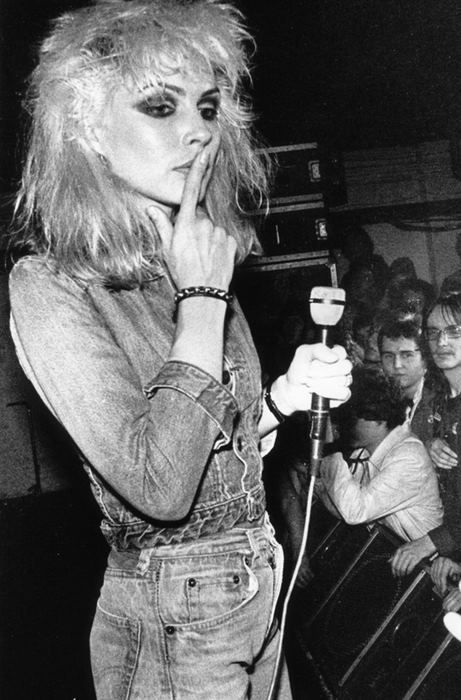 Debbie Harry of Blondie in distressed denim, which is another fashion trend from the heroin chic era in the 90's. Denim was already trending during the 1990s, but heroin chic popularized distressed, faded, and ripped denim.