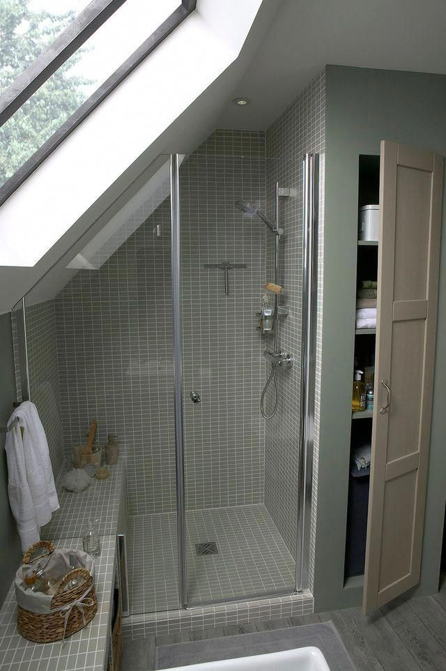 Another shower tucked under the eaves. Love the be…