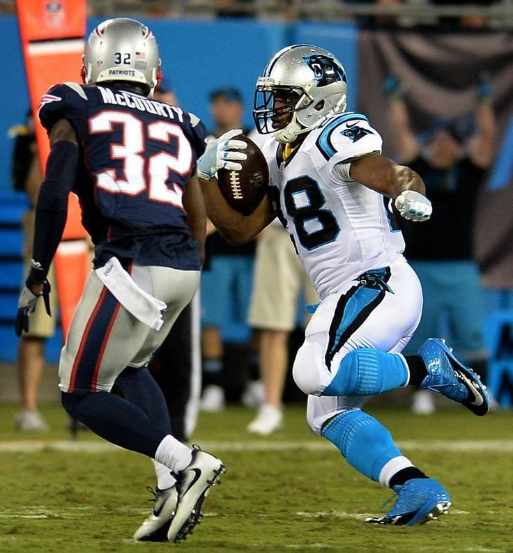 Carolina Panthers running back Jonathan Stewart, right, looks to break to the…