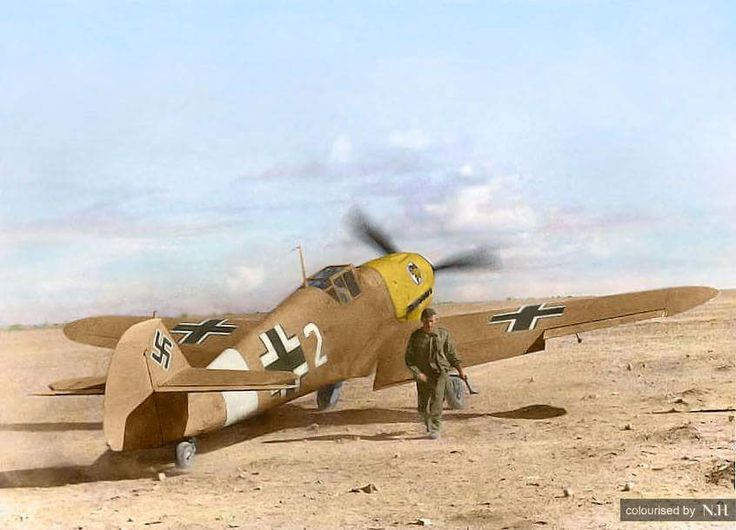 "Messerschmitt Bf-109 F-4/Trop of I./JG 27(Jagdgeschwader),""White 2"",in North Africa,Libya,Autumn of 1942.The engine just started running and the ground mechanic moves away from the aircraft holding a..."