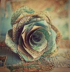 Make a rose from a map of each place that you've traveled and make your own bouquet....just an idea :)