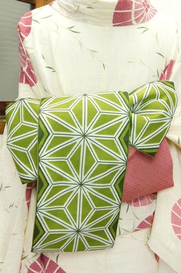 おだやかな鴬色に、大胆な麻の葉文様が織り出された半幅帯です。 #kimono