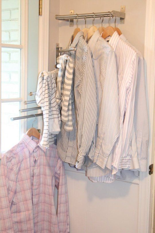 "DIY Laundry Drying Racks: She bought two of the swinging racks that will dry up to 8 adult shirts and one double 15"" towel bar for shirts that dry on hangers. They all tuck up against the wall behind the french door!"