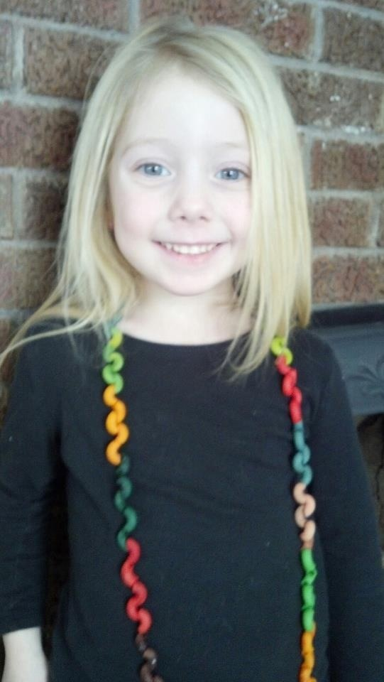 We made this macaroni necklace for her 100th day of school project. We took noodles and dyed them like you would dye Easter eggs. Let dry overnight and string them together. This zig zag pattern happens when u string them :)