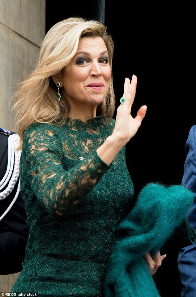 Queen Maxima of the Netherlands chose an elegant, long-sleeved lace dress in a festive sha...
