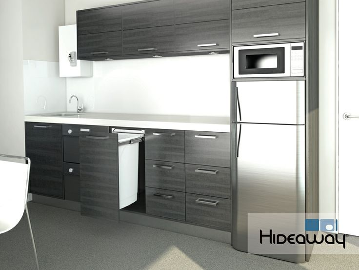 A Hideaway Bin in a corporate kitchen helps maintain a flowing and clutter-free bench top and floor space, keeping waste neatly tucked away.