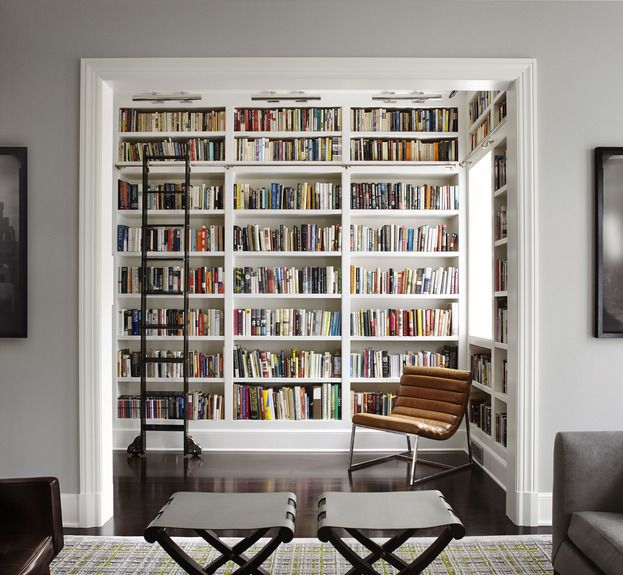 Library off the living room. Please! When I build my fortress I will have this with the perfect chair or chaise, a cup of coffee, and my Great Dane lounging at my toes.