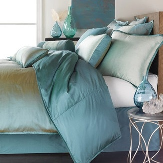 Peaceful, spa-like turquoise bedding.