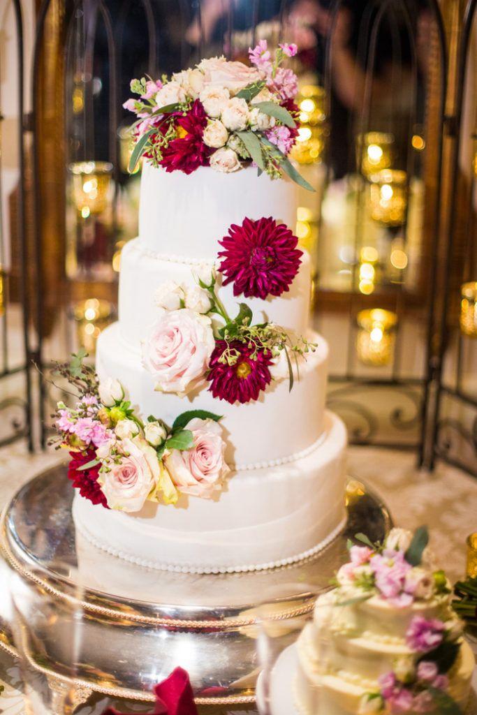 four-tier-round-wedding-cake-beaded-border. Fairmont Hotel Washington DC wedding. Colonnade Room. Burgundy, red, pink, ivory. Wedding Coordination: Event Accomplished. Photo: Kurstin Roe