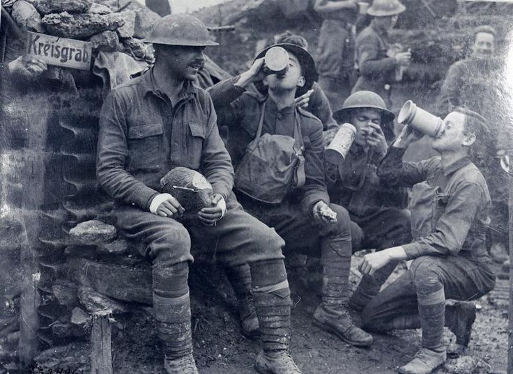 American soldiers of the 33rd Infantry Division enjoying beer, bread and cigars abandoned by the Germans in a trench near Consenvoye, 1918. http://i.imgur.com/GaBasR8.jpg