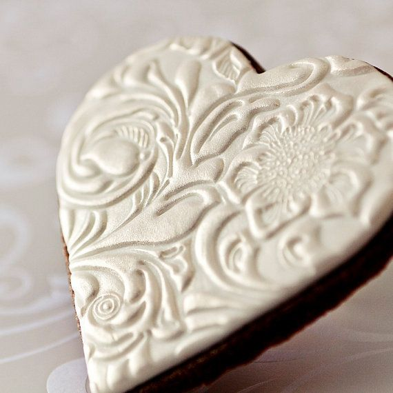 Romantic, elegant and uniquely textured, these sophisticated cookies let your guests know how very much you appreciate them sharing your special day with you.