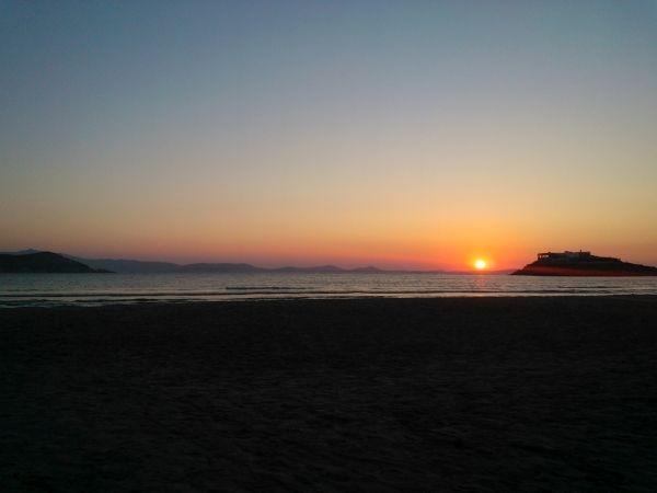 As the sun goes down, Agios Georgios beach