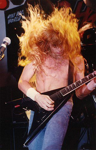 """Dave Mustaine, Megadeth, Jackson Flying V.  No tattoos because """"you don't put a bumper sticker on a Mercedes-Benz.""""  Mustaine was original lead guitarist for Metallica."""