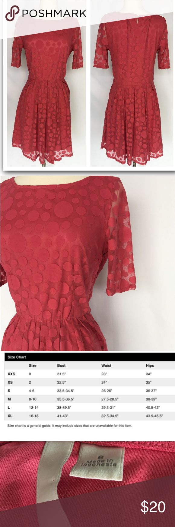 "LC Lauren Conrad coral polka dot dress size 6 Gently used LC Lauren Conrad coral polka dot dress size 6. No stains or holes. Please see last picture- the rubber band closure in the back has come undone, but dress is in otherwise good condition. Material polyester and nylon. Dress is fully lined with zipper closure. Length is 35"". LC Lauren Conrad Dresses Long Sleeve"