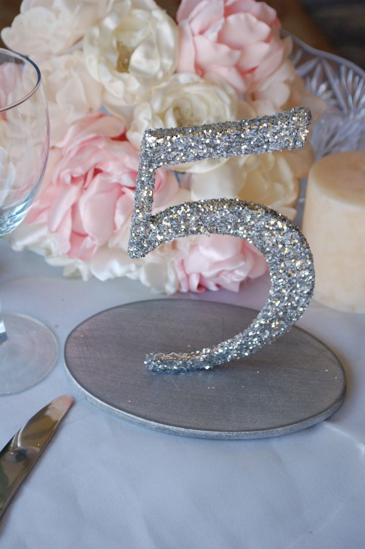 Glitter Wedding Table Numbers - Silver / Gold 1-10. $85.00, via Etsy.  Also comes in champagne or pink.  looks like very nicely chunky glitter