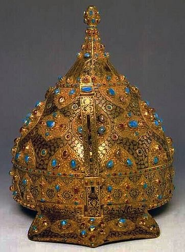 Ottoman Empire jeweled and gold-inlaid steel ceremonial chichak, a type of helmet (migfer) originally worn in the 15th-16th century by cavalry of the Ottoman Empire, consisting of a rounded bowl with ear flaps, a peak with a sliding nose guard passing through the peak, and an extension in the back to protect the neck. Various other countries used their own versions of the chichak including Mughal India, and in Europe, mid sixteenth century, Topkapi Palace Museum, Istanbul Turkey.
