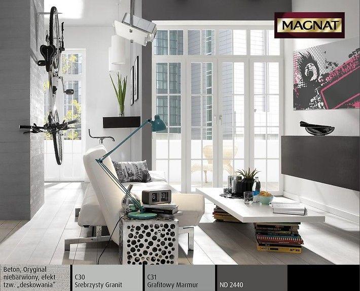 Mieszkanie w stylu loft w miejskich kolorach szarości z designerskimi dodatkami. Minimalistyczny charakter wnętrza podkreśla dekoracja filaru: struktura surowego betonu. To przestrzeń kipiąca aktywnością, a równocześnie azyl dla niespokojnych duchów.