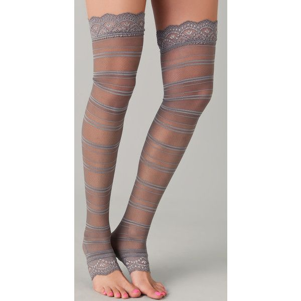 These sheer, thigh-high toeless tights feature shadow stripes and scalloped lace edges. 92% polyamide/8% spandex. Hand wash. Made in Germany.