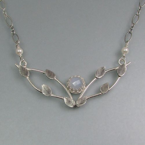 "Double vine necklace with blue chalcedony and hand engraved leaves in sterling silver.  Limited edition necklace""Spray of Sky Light Vine Necklace"" by Kryzia Kreations  http://www.kryziakreationsstudio.com/products/vine-necklace-with-blue-chalcedony  $240.00"