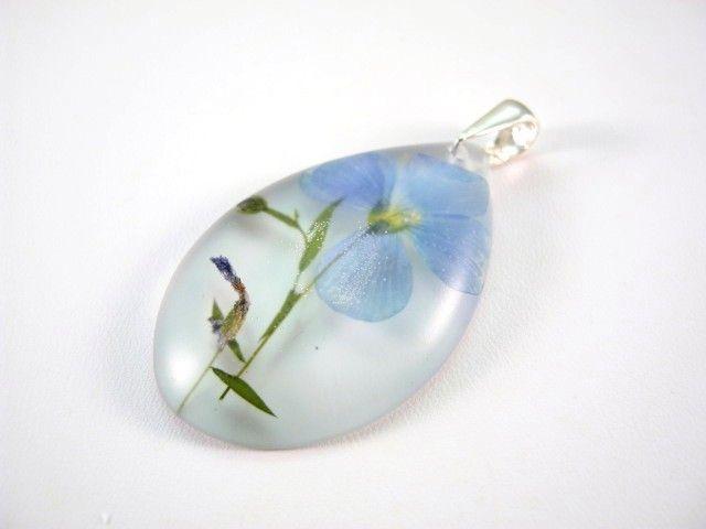 Flower of Flax preserved in resin. http://en.dawanda.com/product/49224018-Anhaenger---Lein---925-Silber