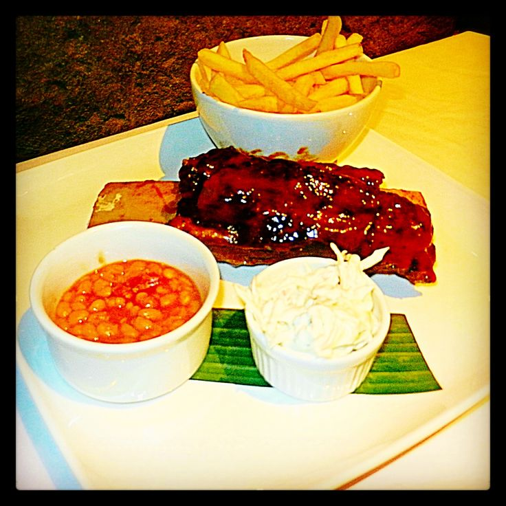 Rio's Barbeque Beef Rib: 12oz. Succulent beef short rib, slow cooked and glazed with RFC barbeque sauce and served with creamy southern slaw, baked beans and fries.