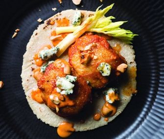 Chicken Wing Tacos with Salsa Macha | This dish from New York City taco guru and Beard Award semifinalist Alex Stupak riffs on traditional game-day chicken wings with a fiery, addictive salsa made with peanuts, sesame seeds, garlic, honey, and chiles. Bring. It. On.
