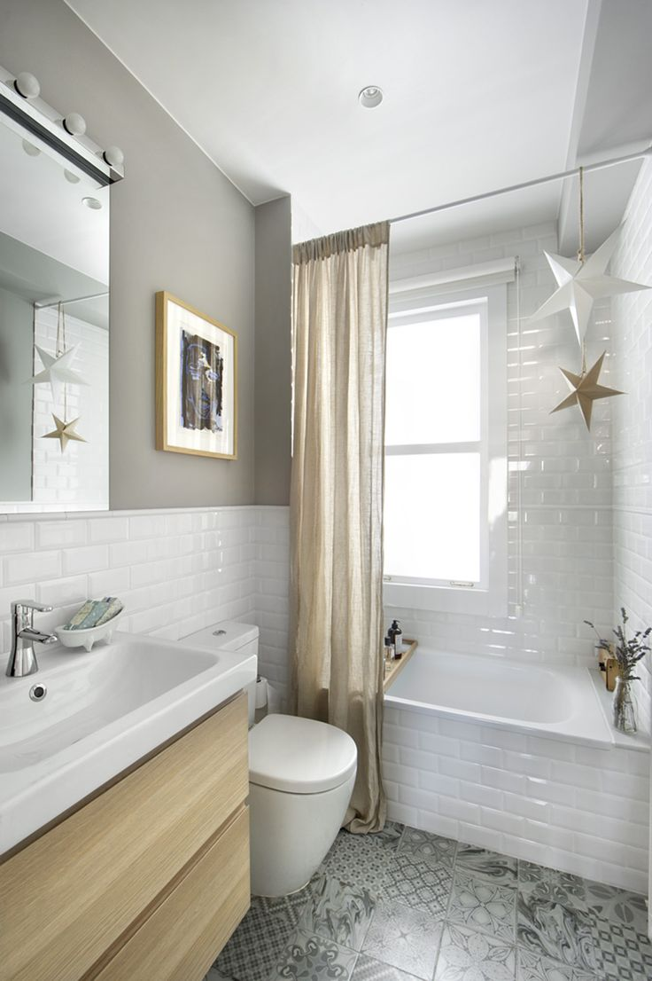 This well designed small bathroom includes a space-saving shower bath, short project toilet and wall hung vanity unit.