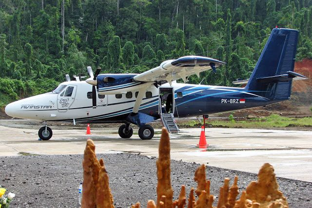 Twin Otter aircraft owned airline Aviastar landed at the airport Marinda - Raja Ampat