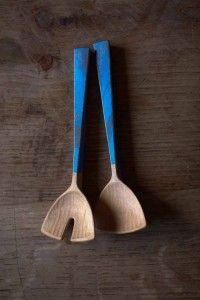A pair of tiny salad servers by Fritiof Runhall with blue painted handles.
