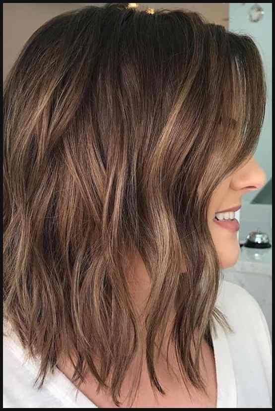 Brunette balayage ; wavy hair ; brown highlights ; long bob …