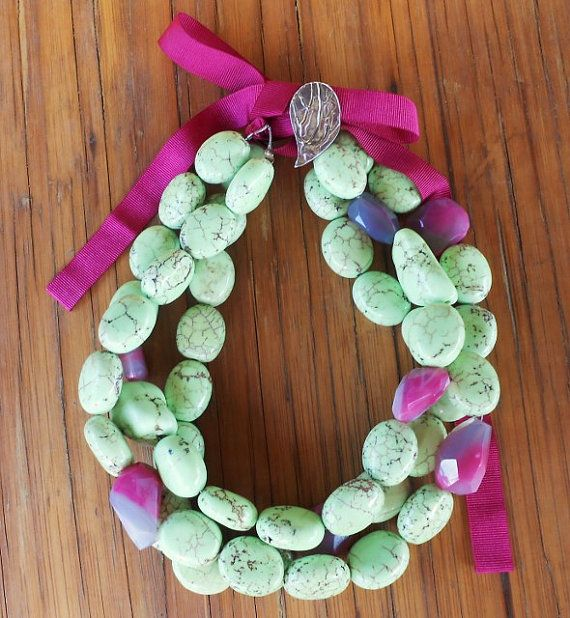 A statement necklace with real gemstones! Light Green Turquoise and Fuchsia Agate are the gemstones ,the decorative clasp is handmade and made by silver 925.The height of the necklace is adjustable from the ribbon.Only one is available.