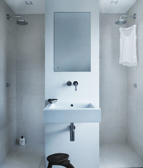 put two, one on either side with the opening in the center,and center a window on the back shower wall, add a shelf over the sink and a door wall on her side